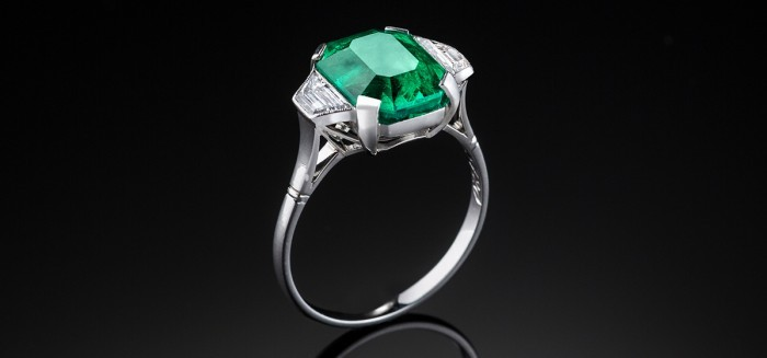 A French Art Deco large Columbian emerald and diamond platinum ring