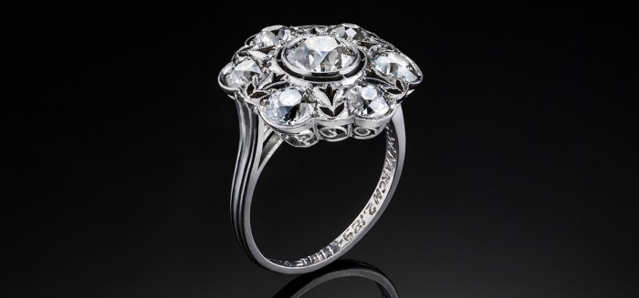 A large antique Edwardian era old cut diamond and platinum cluster ring