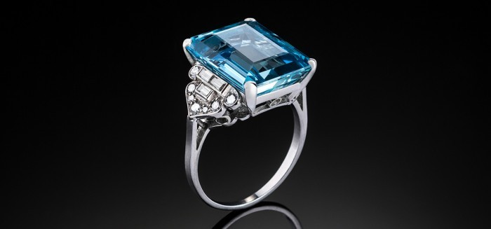 An Art Deco large aquamarine and diamond platinum set ring