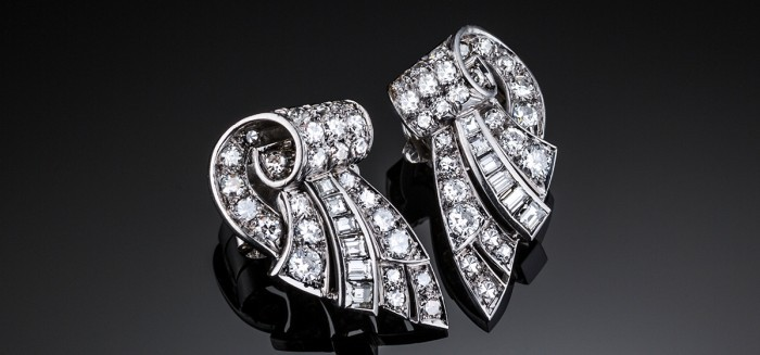 French Art Deco diamond set platinum ear clips in a scrolled wing design