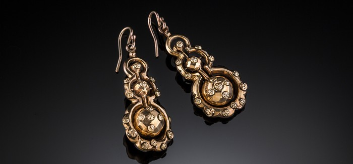 Antique yellow gold drop earrings with a central pendulum of graduated orbs