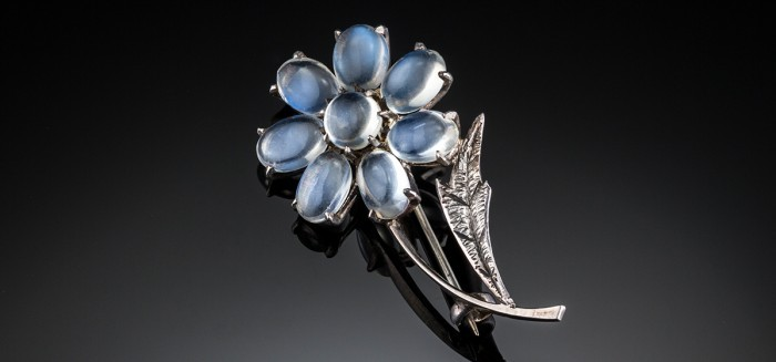 A 1940s sterling silver and moonstone flower brooch