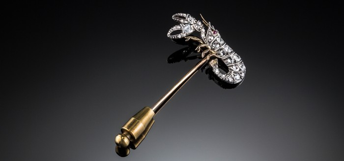 An antique diamond lobster stick pin set in silver topped gold