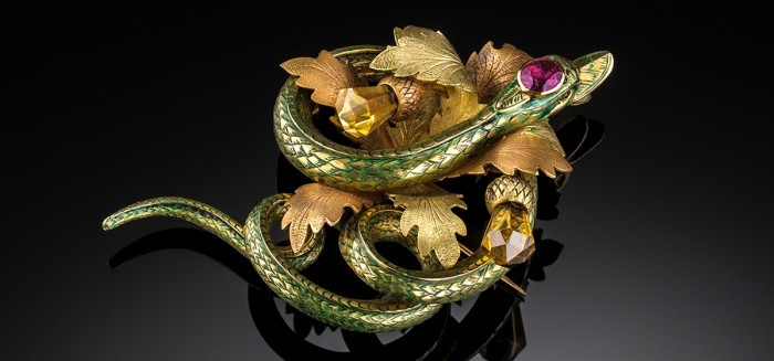 A large Antique enamel and yellow gold gem set serpent brooch