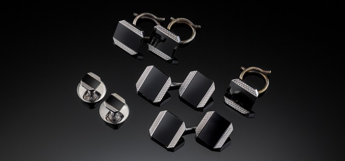 An Art Deco white gold and black enamel dinner set by Cropp and Farr