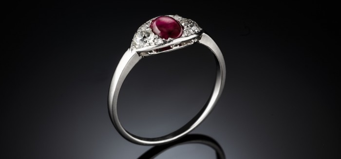 An art deco ruby and diamond set platinum and gold ring